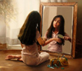 Girl at the mirror ( Oil on canvas 60 x 70 cm - year: 2004 )